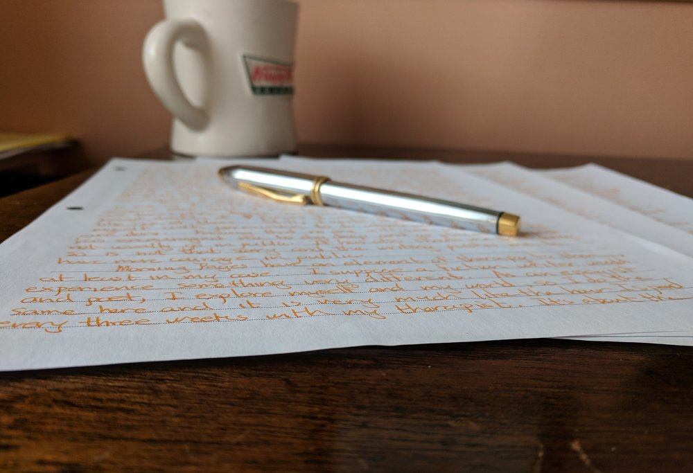 This morning's pages, pen,and the empty coffee cup.