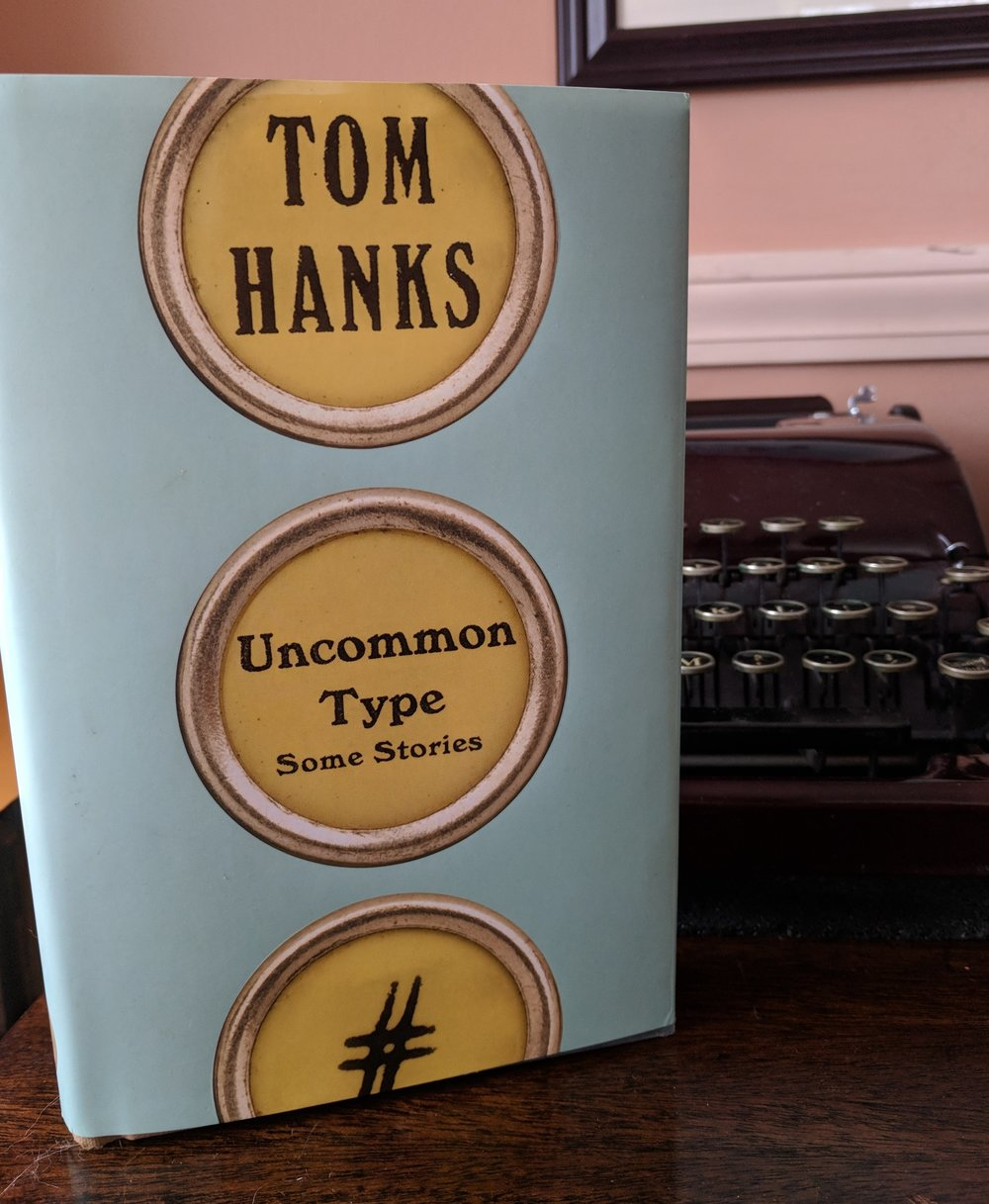Tom HanksUncommon Type - These are good stories. They are weird stories too and it's the weirdness that I find most interesting. What's weird? There are more happy endings than tragic ones and yet it does not diminish the stories. It's not as if they had unhappy endings, screen-tested poorly, and were rewritten at the studio's insistence. At least, I don't think any of that went on. Instead, I think it was Nora Ephron's influence and Tom Hanks' character that brought this about. I'm grateful for whatever did it. It's good to be reminded that comedy (in the dramatic sense rather than ha-ha) can be as powerful as tragedy. Tom Hanks is a good writer and he likes typewriters even more than I do.