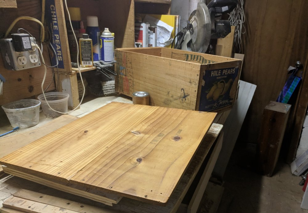 Lap desk top, another pear crate, the workbench and shop