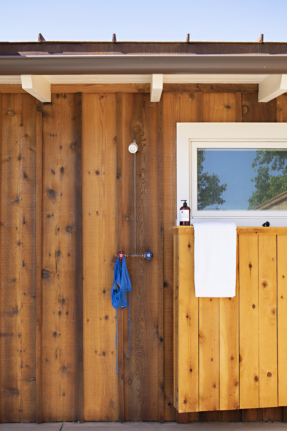 Cozy outdoor showers with hillside views in select rooms.