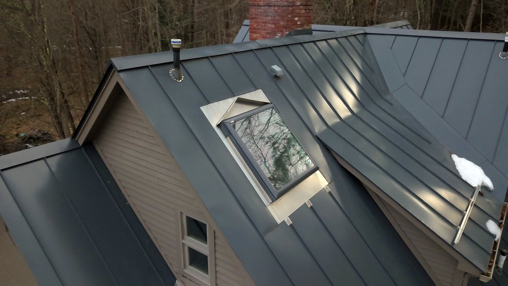 EZ CURB   Finally, a real solution for skylights in metal roofing