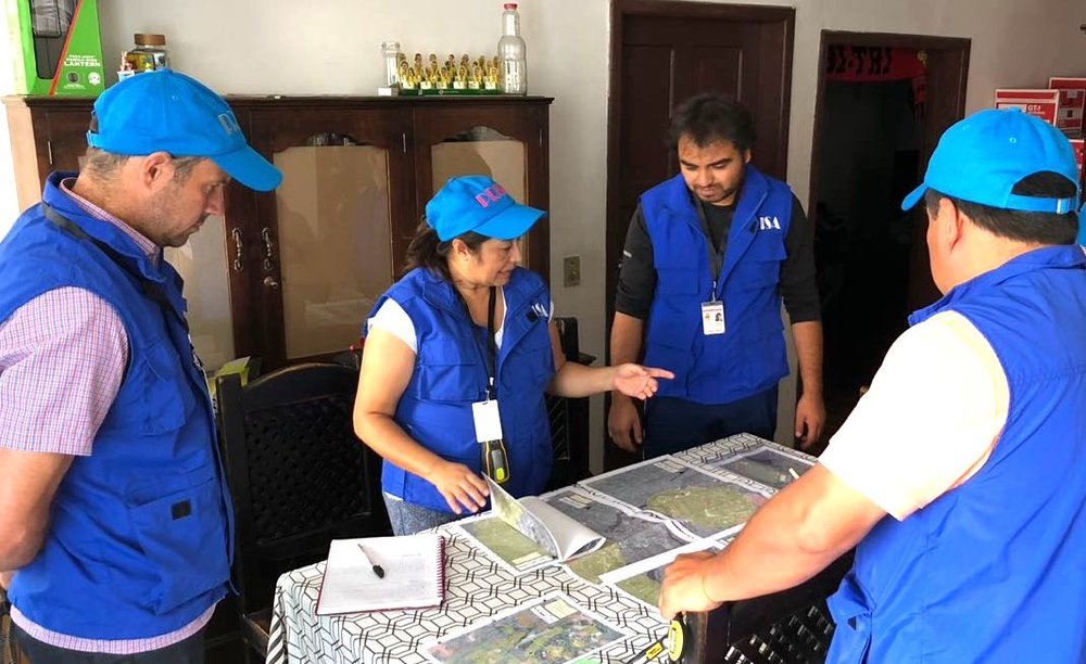 The NIH-funded  PRISA field research team , including researchers from UC Berkeley and La Universidad San Francisco de Quito, reviewing maps of semi-rural communities east of Quito, Ecuador - July 2018.