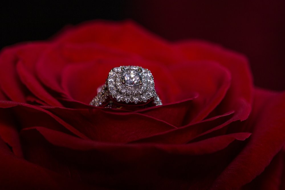 Raleigh, NC wedding photographer- Detail of engagement ring on red rose.