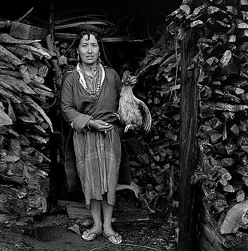 Dorji Dema and her hen in Merak village, 2001-2006