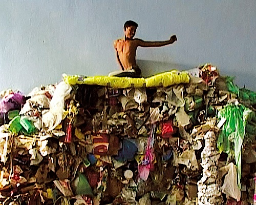 (Video Still) The Brief Ascension of Marian Hussain, from the series Trash, 2005
