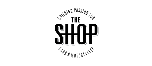 WINGS.WHITE.IMAGE-500px-The_Shop_Logo.png