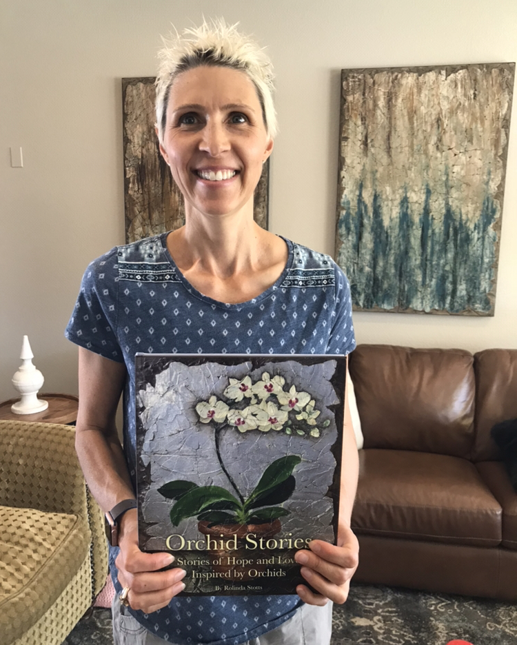 Stephanie holding her copy of the sold out Limited Edition of Orchid Stories. October 2018
