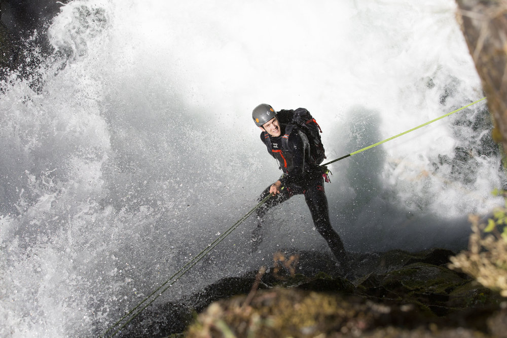Repelling into a waterfall in the Columbia River Gorge.