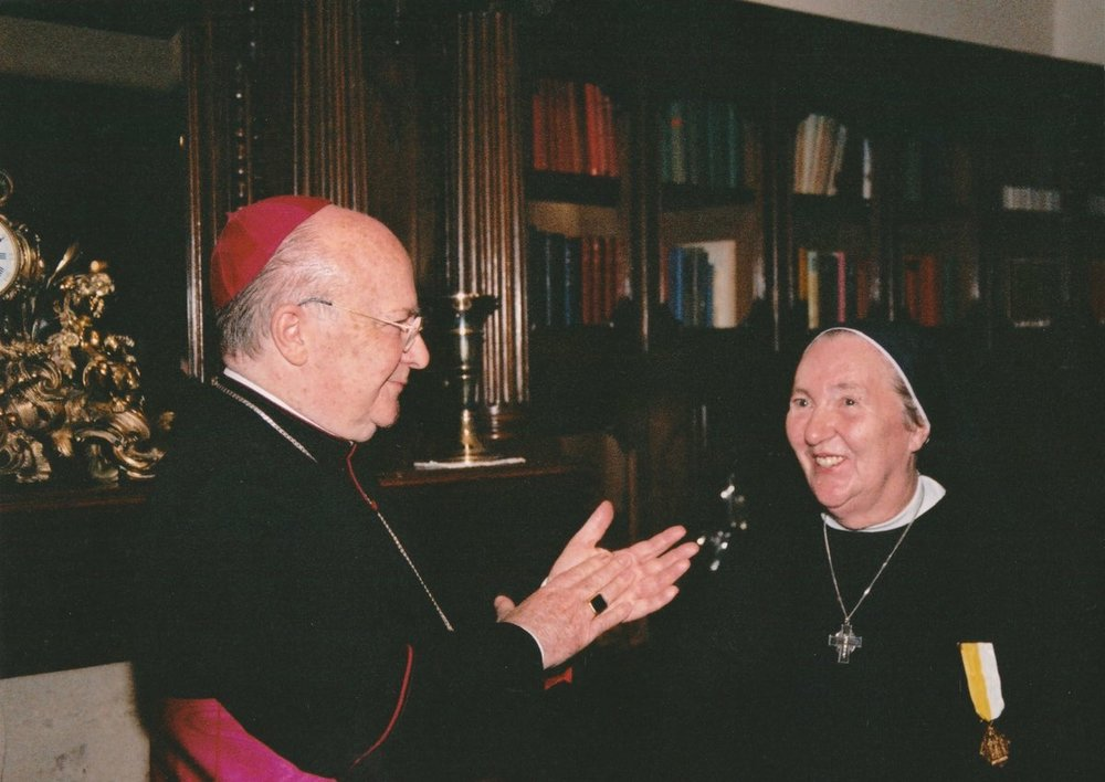 Mother Mary receiving the Pro Ecclesia et Pontifice from the Papal Nuncio