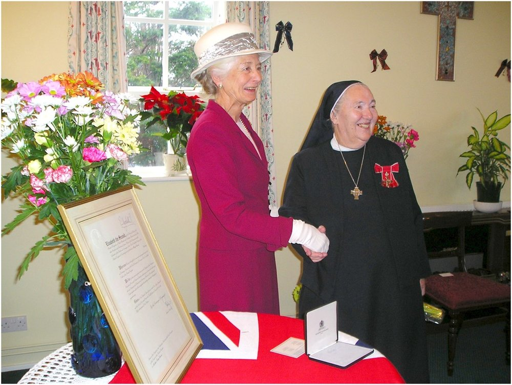 Mother Mary receiving the MBE