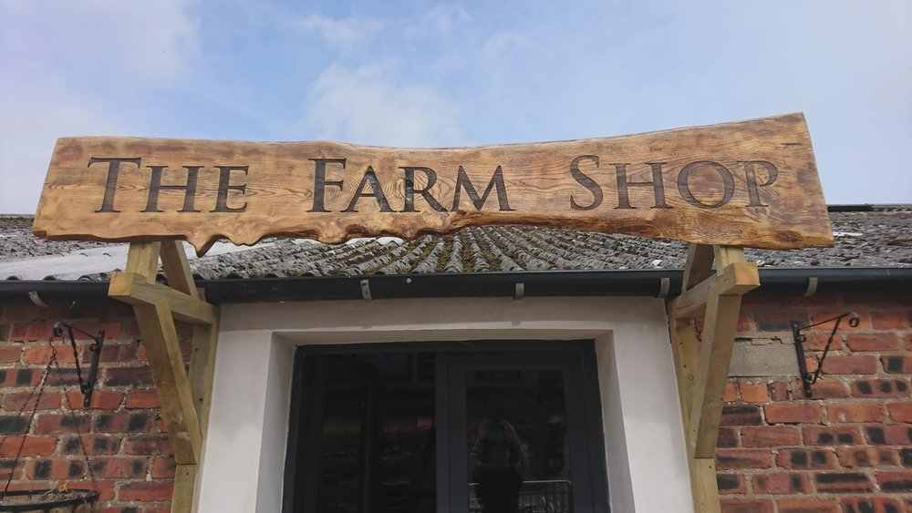 Shop sign for the Buffalo Farm