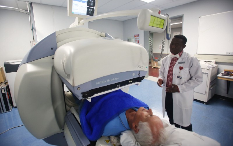 Being posted under the gamma camera, Prof Mike Sathekge looking on. Image by Masi Losi