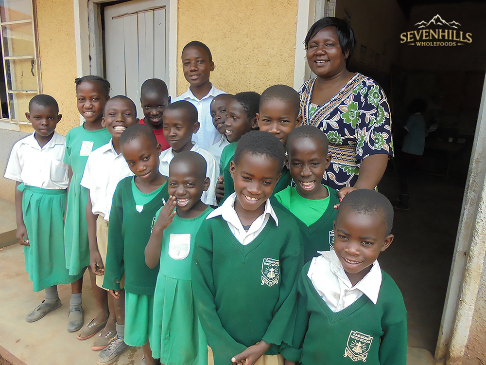 Teacher Juliette with some of the CESP children at Namugongo Mixed Primary School