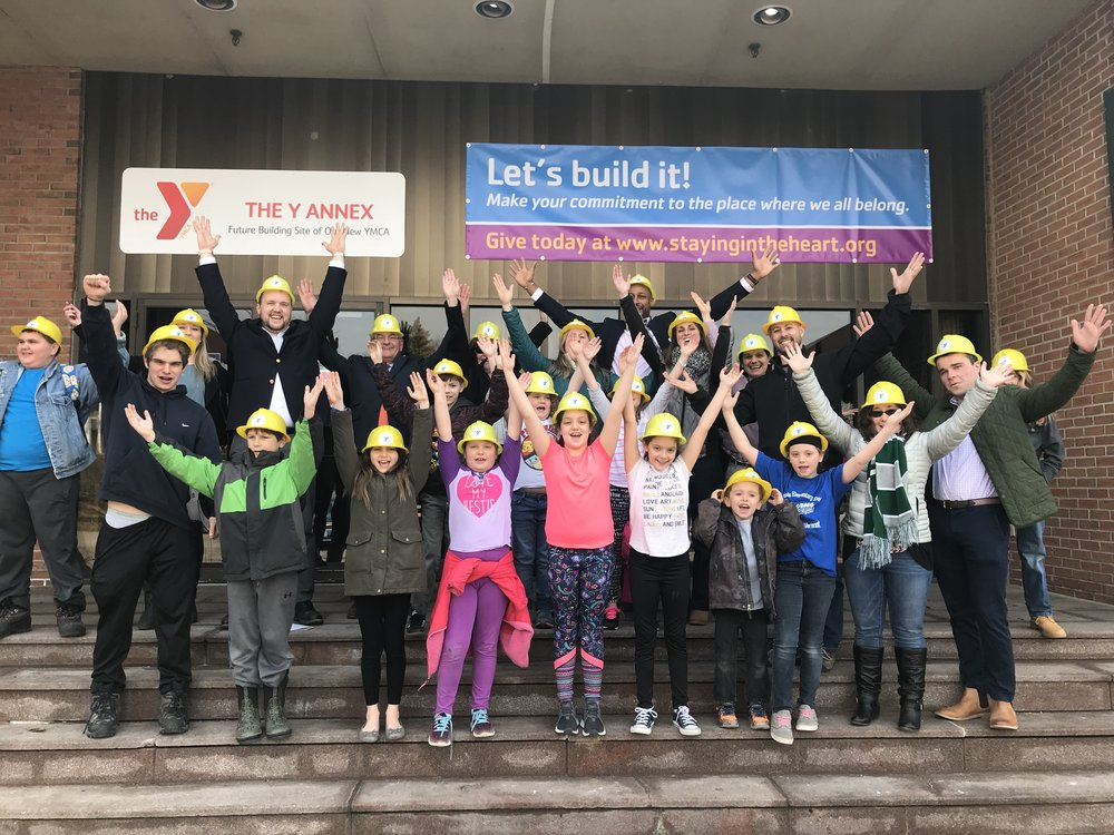Kids and staff in hard hats.jpg