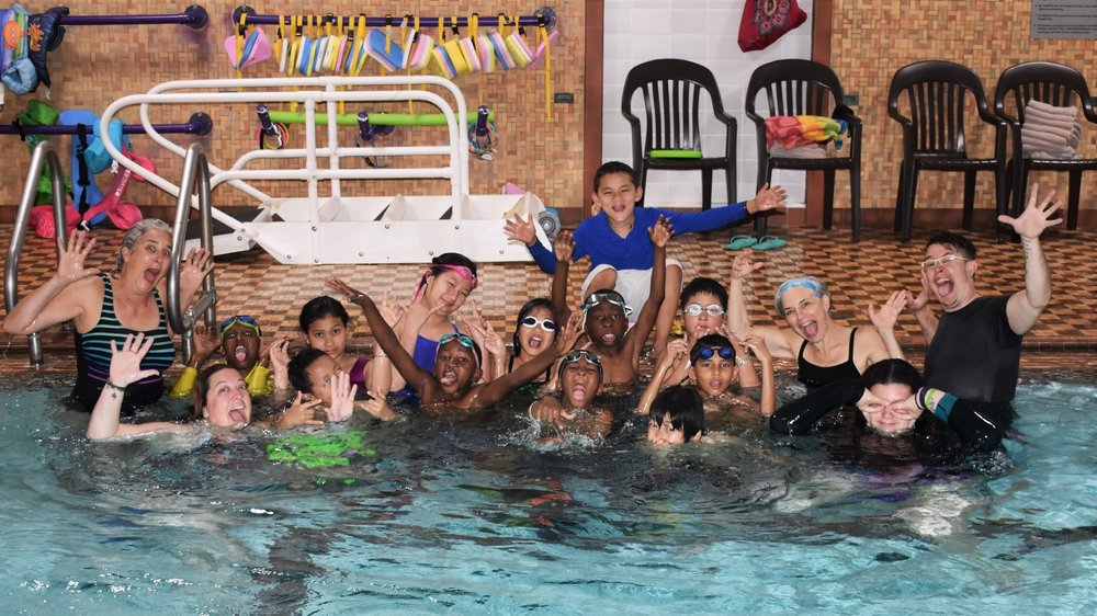 Jess having fun with Camp SPLASH swimmers and instructors