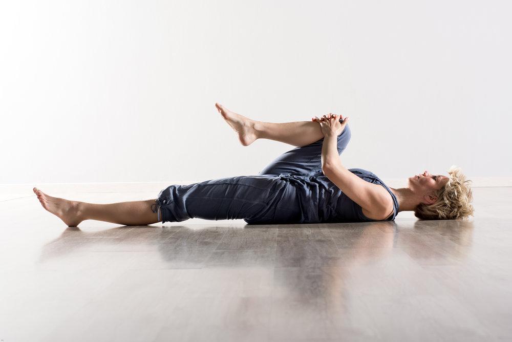 woman-holding-knee-while-stretching-hamstring-EKTU69F.jpg