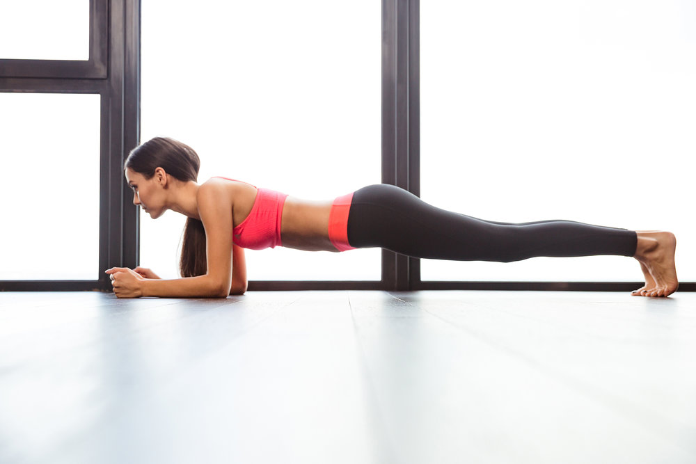 sports-woman-doing-plank-exercise-PGM64WJ.JPG