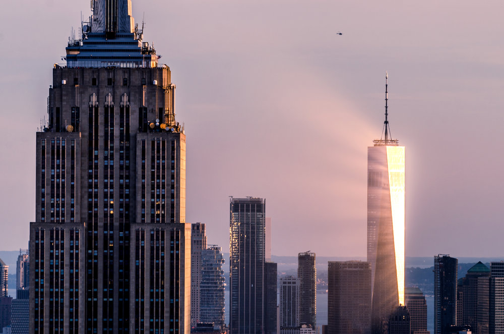 sun-reflection-freedom-tower-sunset-empire-state-rockefeller.jpg