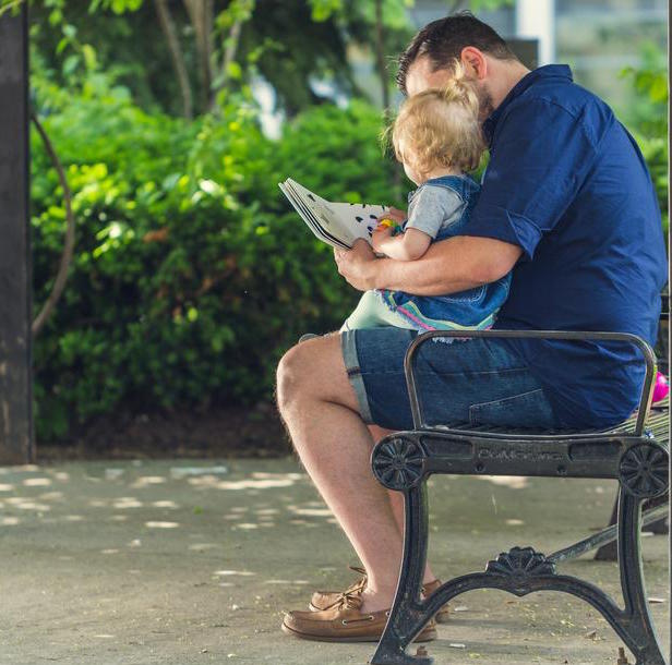 father-reading-to-daughter_925x.jpg