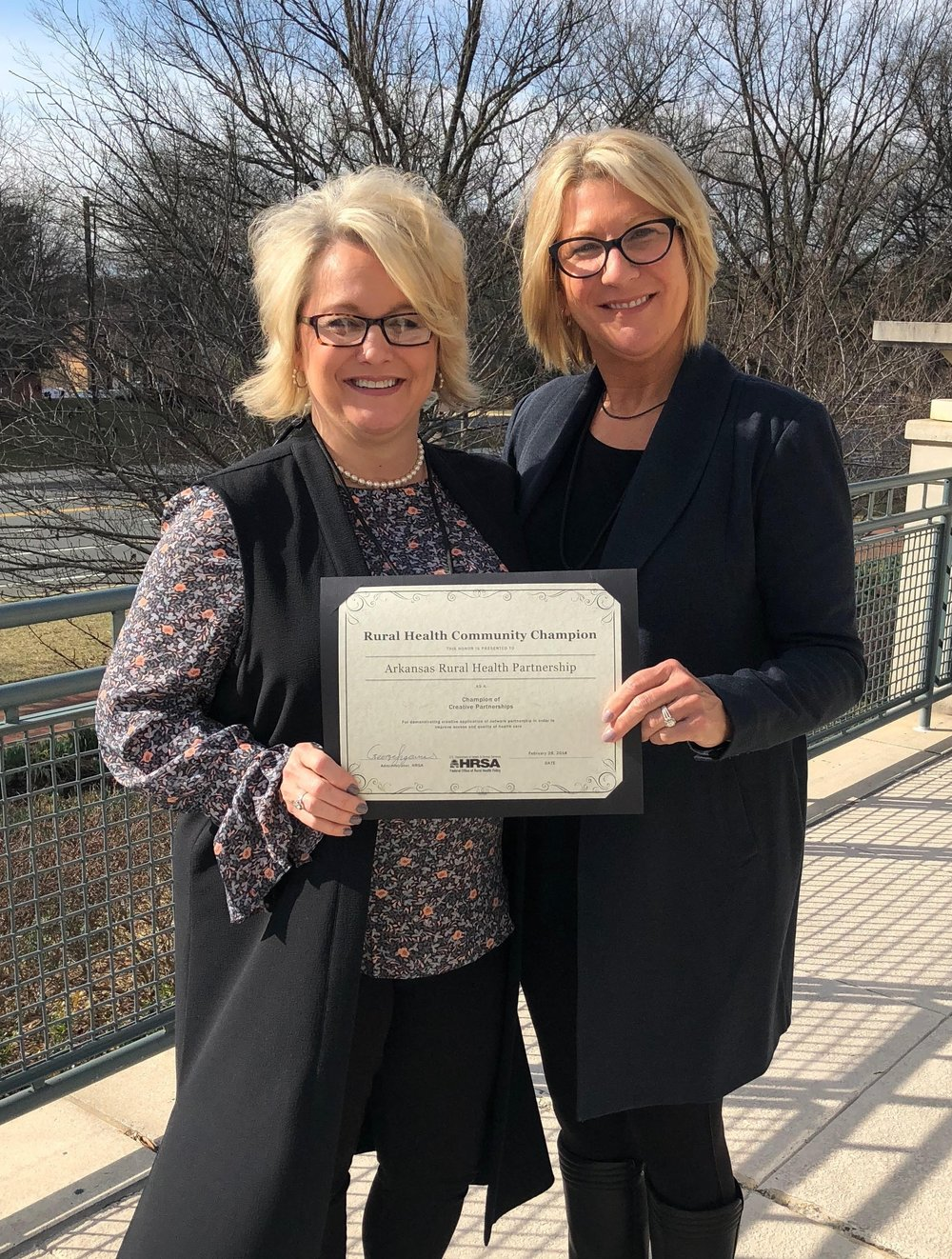 ARHP CEO Mellie Bridewell (R) and COO Lynn Hawkins accept one of only seven nationwide HRSA Rural Health Community Champion Awards. ARHP was recognized as a Champion of Creative Partnership.   - Read full press release here.