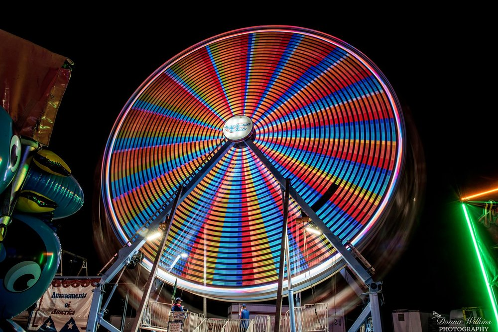 A ferris wheel spinning at the 2017 Vermont State Fair in Rutland, Vermont. Photo by Donna Wilkins.