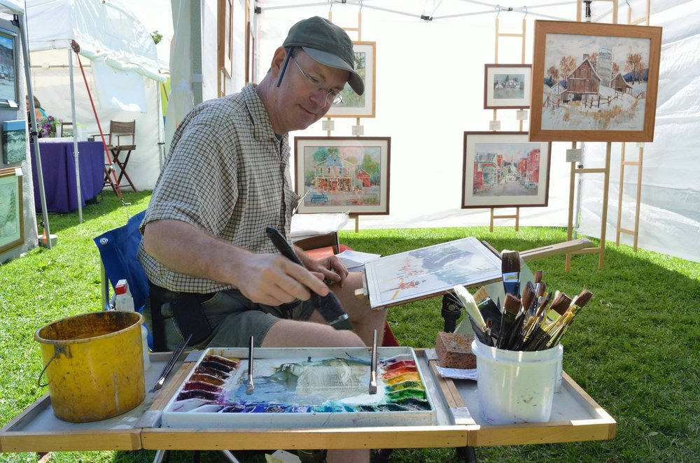 Peter Huntoon paints at Art in the Park.