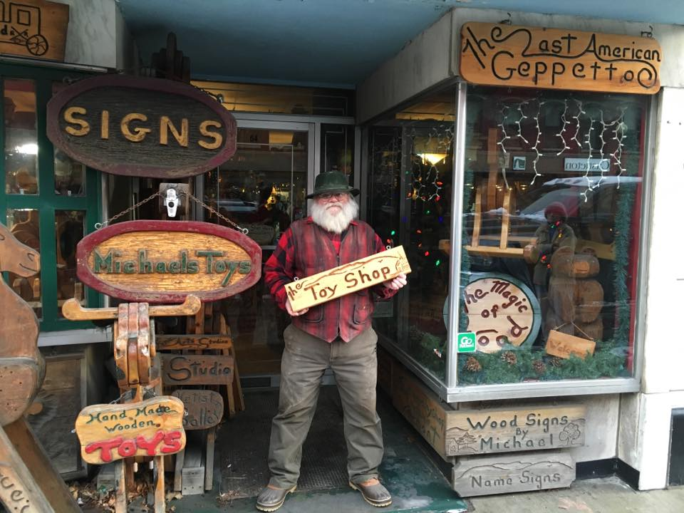 Michael Divoll stands outside of his toy shop on Merchants Row in Downtown Rutland, VT.