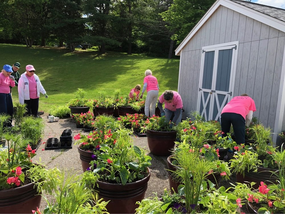 The Rutland Garden Club plants pots before distributing them in Downtown Rutland during the Spring & Summer.