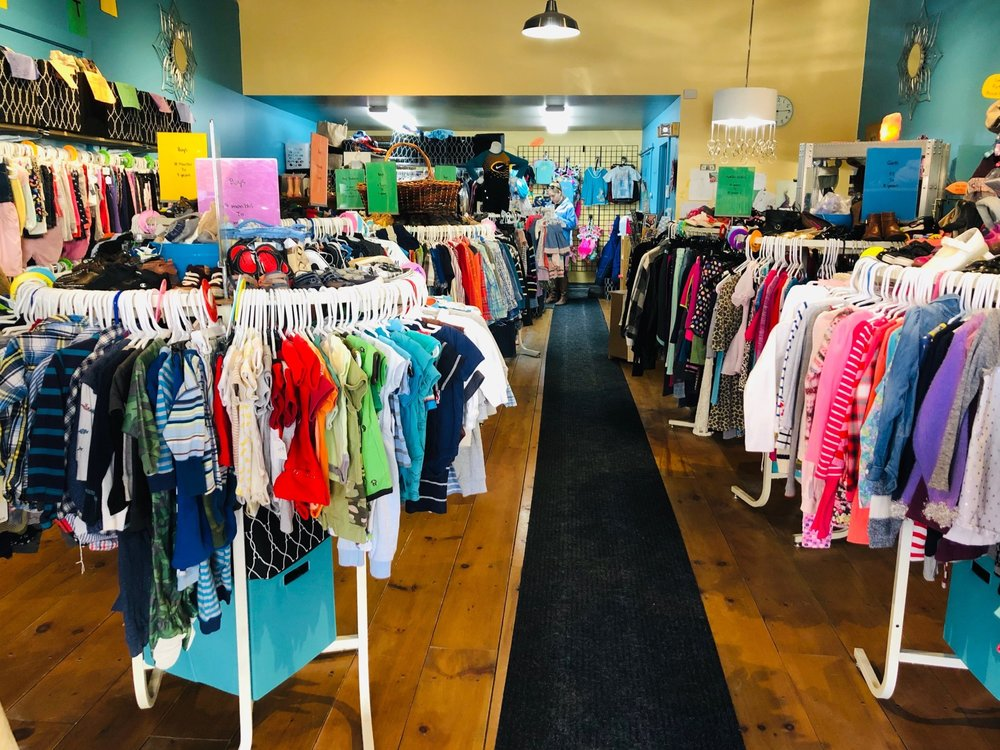 A view of the interior and racks of clothing of Unlimited Potential Consignment Boutique in Downtown Rutland, Vermont.