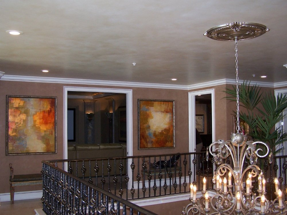 The ceiling has a decorative glaze & the walls are Venetian Plaster.