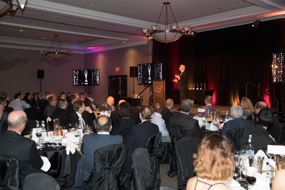 Evening Host and Comedian Scott Faulconbridge emcees the annual DCI Star Awards which commenced during the evening Gala Dinner of the 2017 DCI Business Summit.