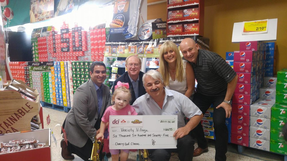 Back Row: Joe Sawaged (CFIG), Tom Shurrie (CFIG), Vicki Bexis (Sun Valley Market), Marc Fortin (DCI) Front Row: Madi Ambos (Variety Village), Jim Bexis (Sun Valley Market)    DCI, CFIG & Sun Valley Market came together on June 28th, 2017 to present the cheque to Variety Village.