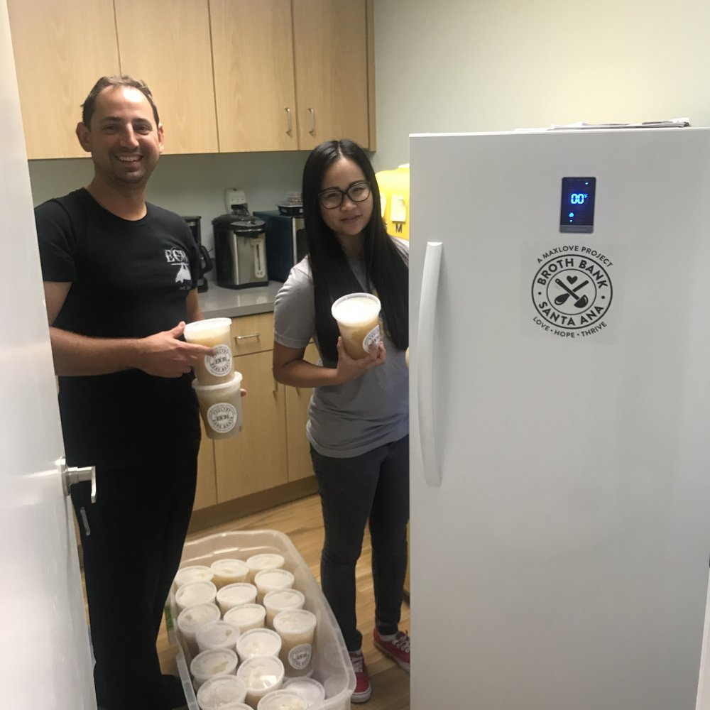 Chef Michael and Angie, loading up our Broth Bank.