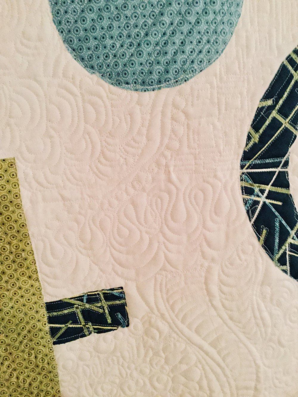 Free motion quilting on modern appliqué