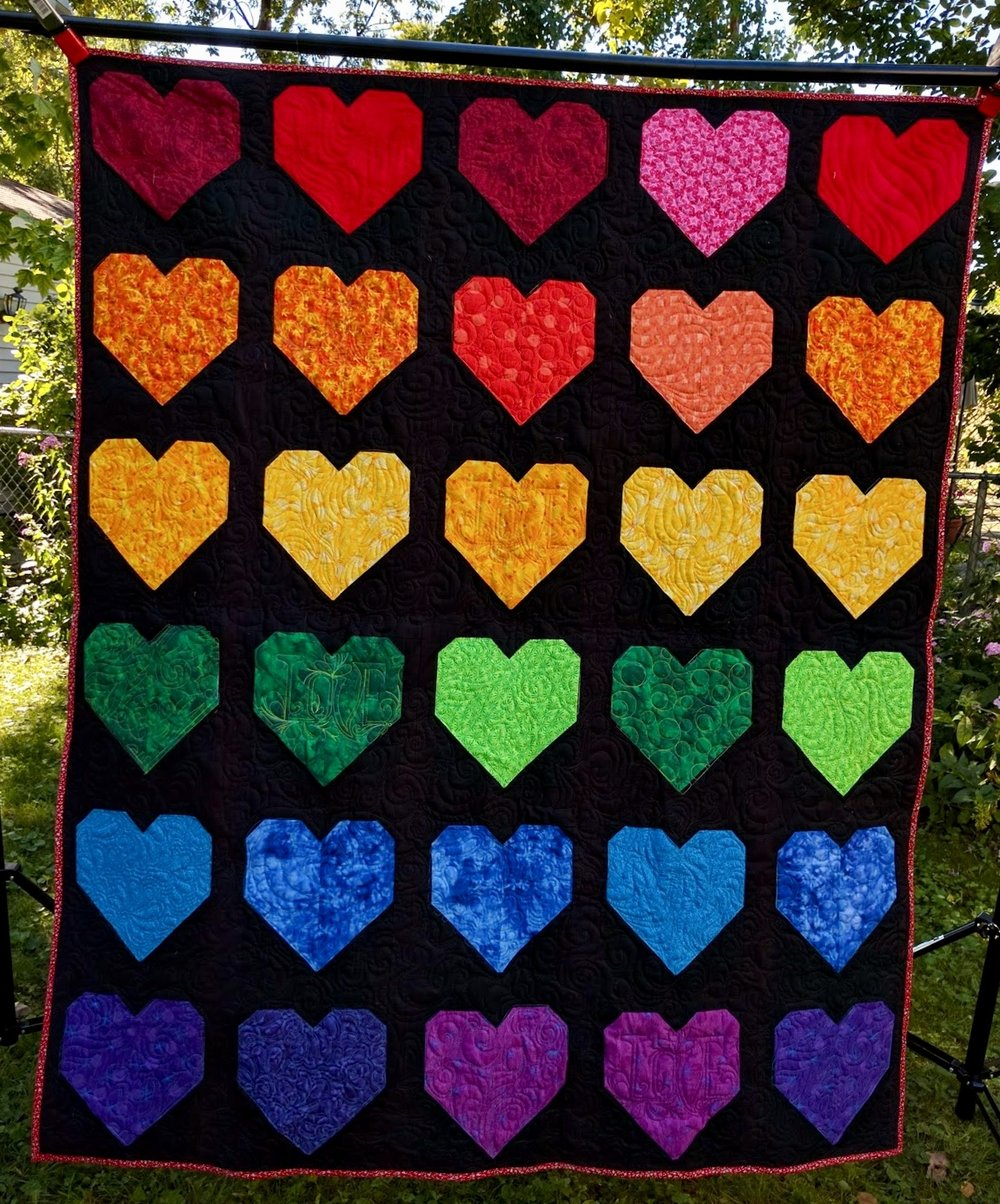Free motion and digital quilting on a donate Quilt for Pulse