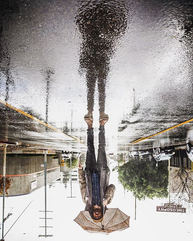 When it rains....it pours. @mykier had to step out front today to test his little umbrella, it still works. #raininginla #wcplusa #reflectiongram #welovela