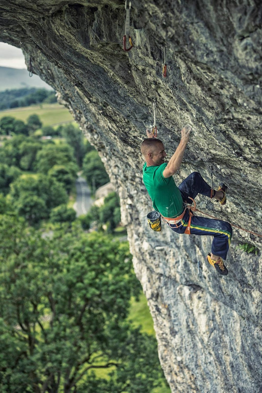 Freakshow 8c, Kilnsey, UK. The crucifix crux move.   Photo: Copyright Lukasz Warzecha