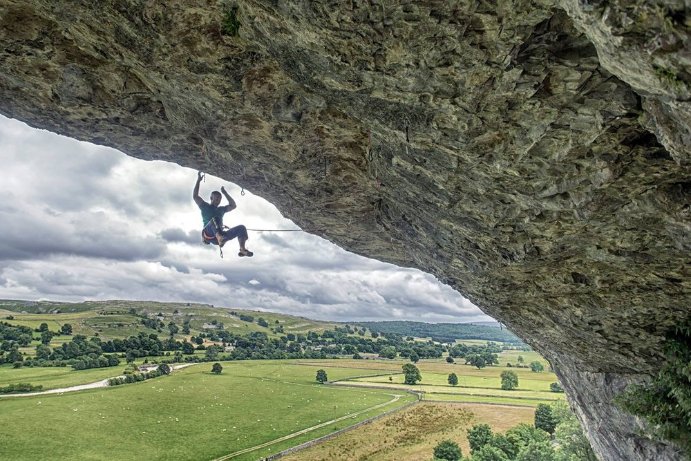 Falling from the final moves of Freakshow 8c, Kilnsey, UK. Photo: Copyright Lukasz Warzecha