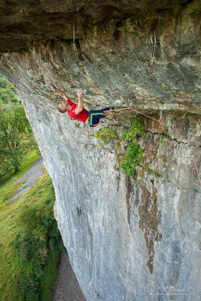 First ascent of Premonition 8b+, Kilnsey, UK.  Photo: Paul Bennett