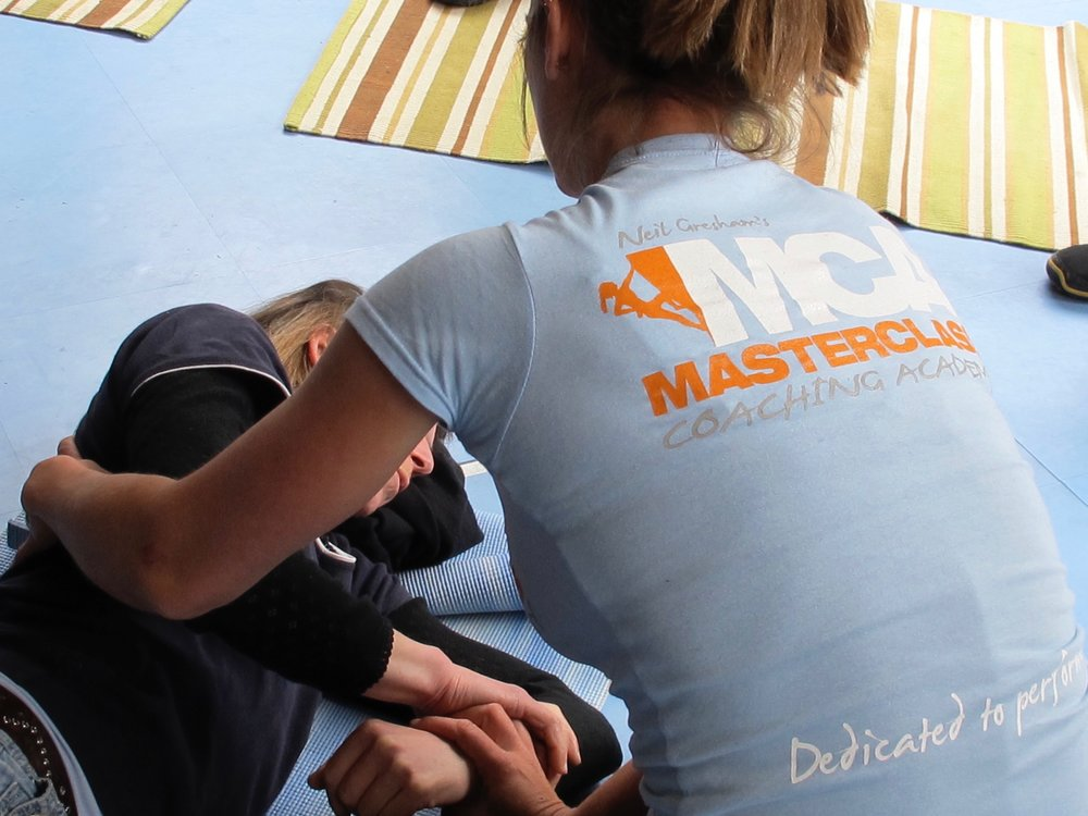 Nina Tappin treating at an injury prevention seminar at Westway CC, London in 2012.
