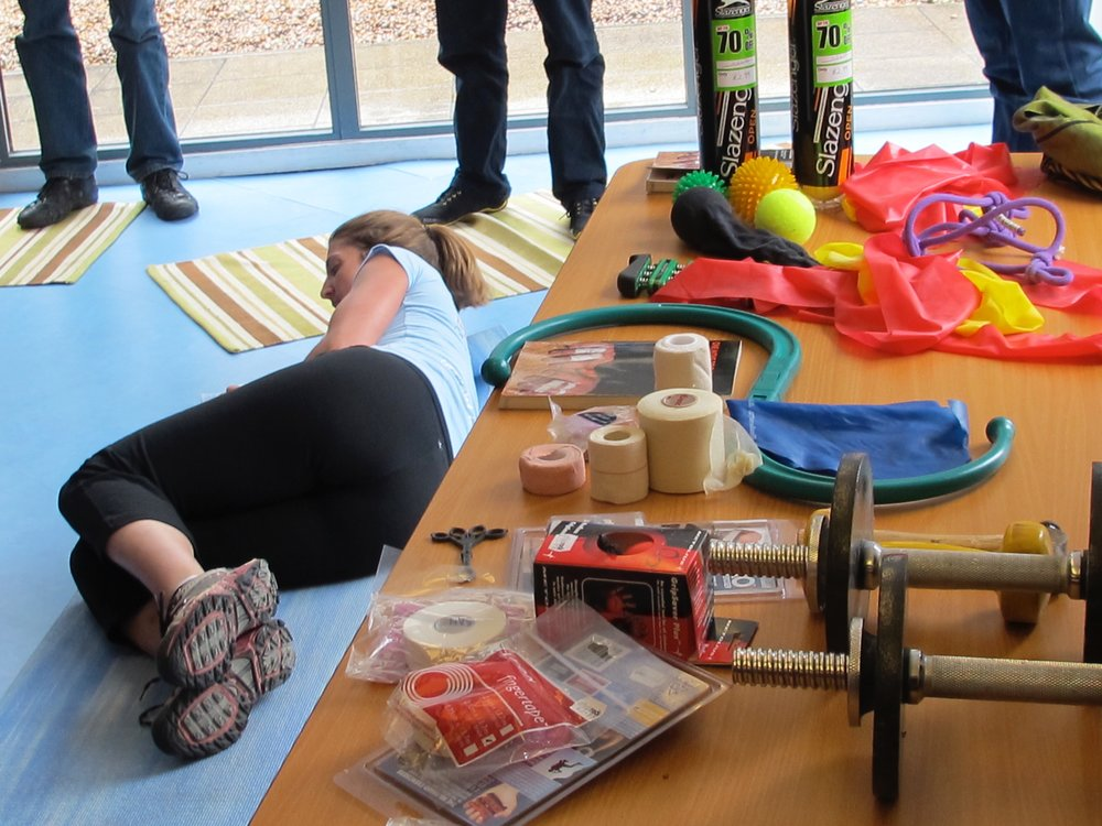 Nina presenting an injury prevention seminar at Westway CC in London in 2012