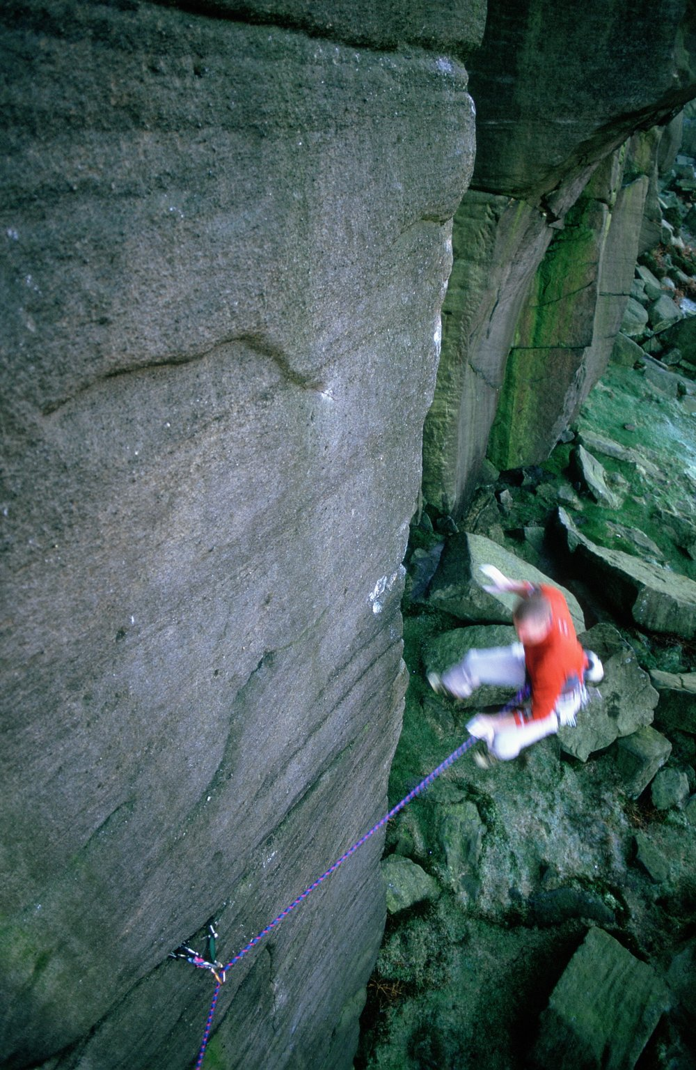Falling from Equilibrium E10 7a, Burbage during the second ascent in 2002.  Photo: Mike Robertson