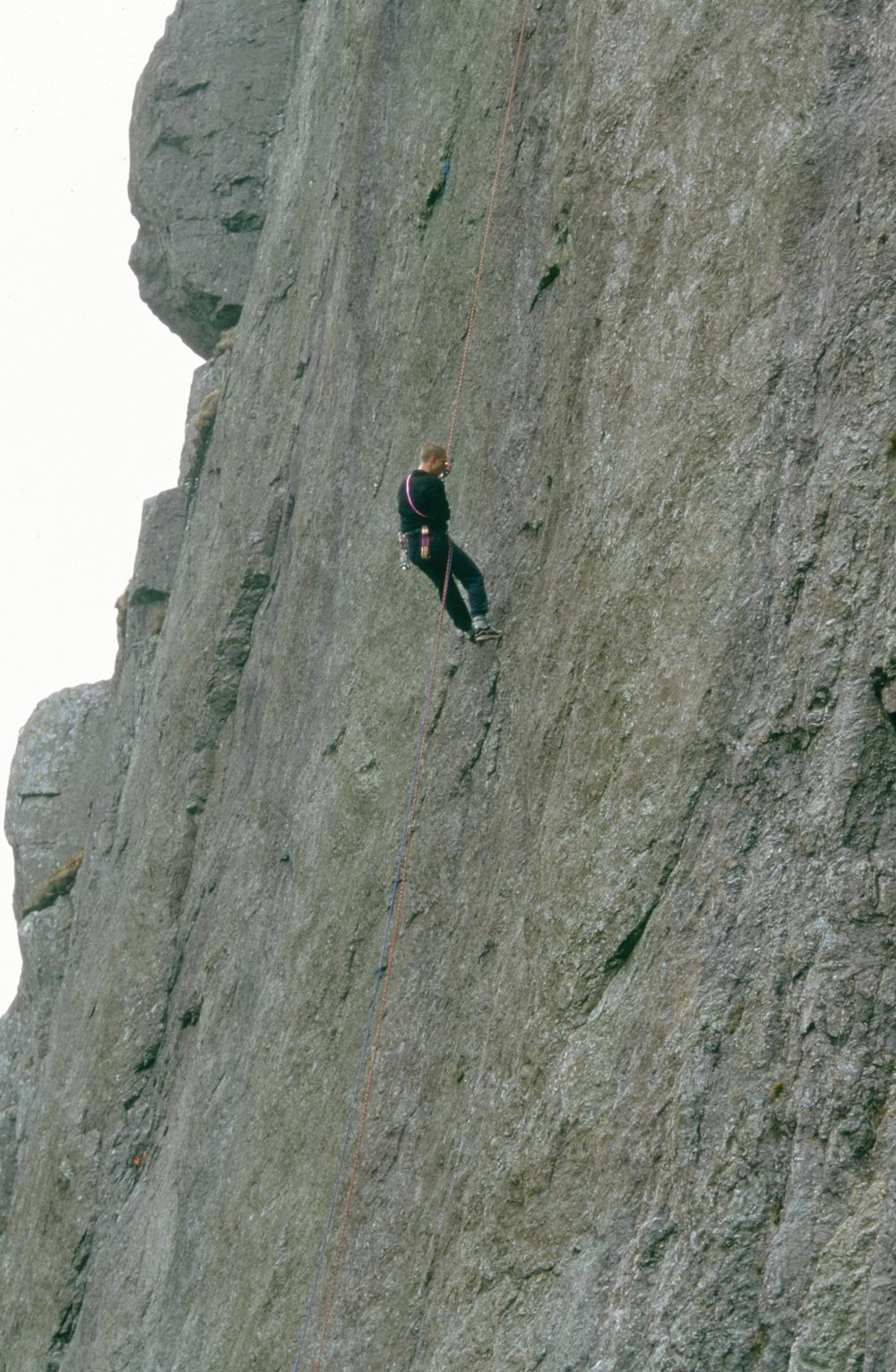 Abseiling down to check the protection on Indian Face E9 6c, prior to making the third ascent in 1996.  Photo: Gresham collection