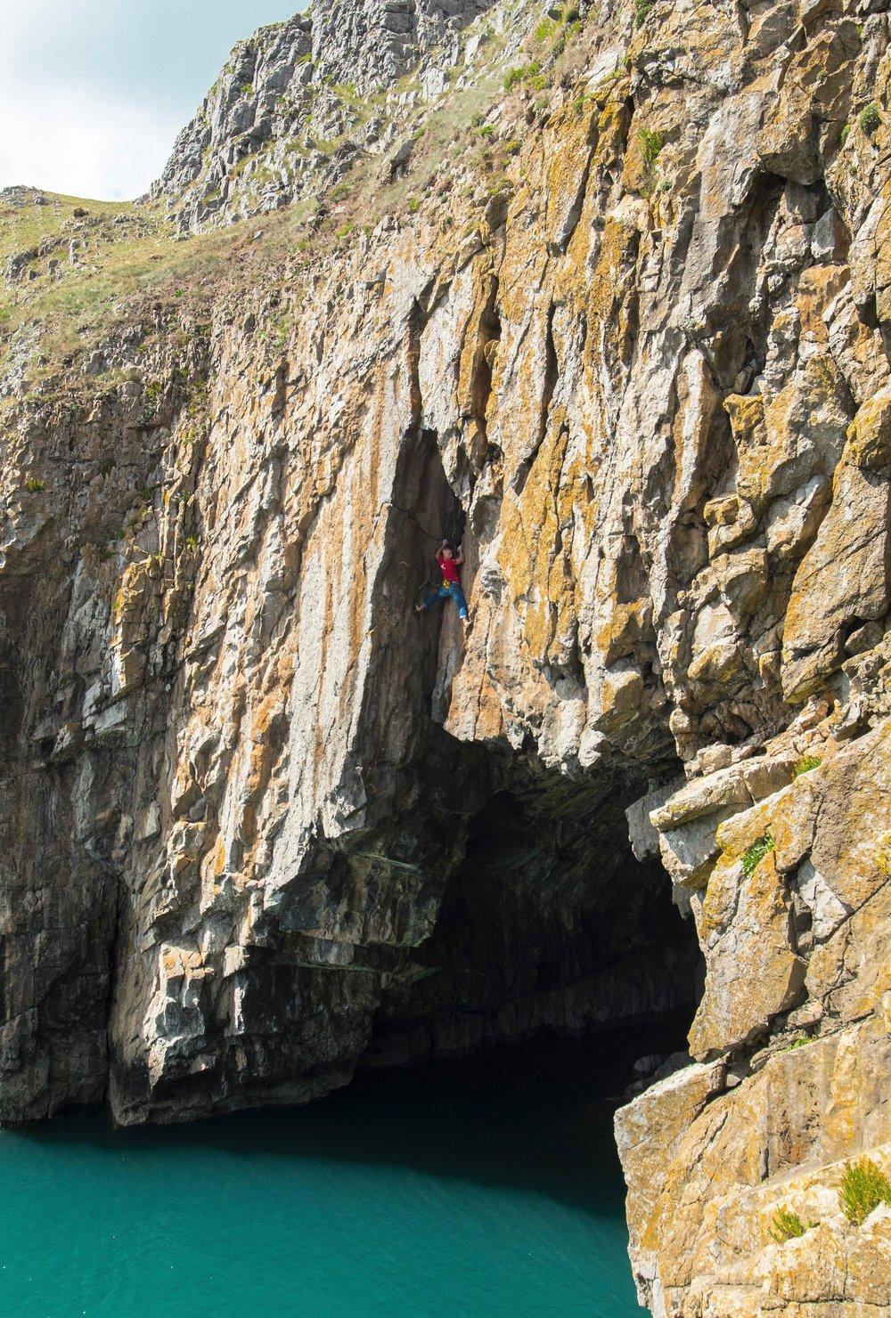 The Abyss 7b S3, Pembroke, UK. Second ascent in 2014.  Photo: Wojtek Kozakeiwicz / LW Images