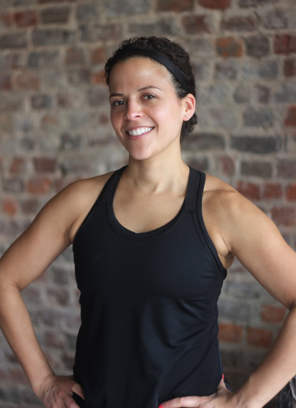 """Emily Bishop - A self-described """"late bloomer"""" to fitness who found big-name gyms intimidating, Emily discovered her love for working out when she found the right small groups to work with. Emily now brings an understanding and appreciation of the small group dynamic and the encouragement it provides to her classes and personal training. Emily is a barre and HIIT instructor (when she isn't working her day job as a lawyer), and she loves watching her clients gain mental and physical strength while learning to truly enjoy fitness. Emily is proof that fitness is for everyone. She found the love of fitness for herself, and will help you find it too.IG @ embishop03"""