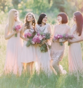 Bride with her bridesmaids are laughting and holding the bouquets of the pink flowers in the green sunny forest (1) (3).jpg