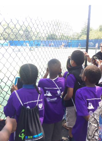 Nathaniel (second from left) gets a chance to snap a few pictures of his favorite pro players while they practice at the US Open during ACE - Baltimore's field trip last August.