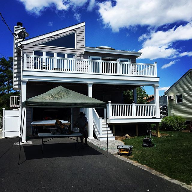 Decking season is upon us! Check out this Aquebogue bi-level water view maintenance free composite deck complete with #tamrail railing system. We used #fiberon composite decking with hidden fasteners for a crisp clean finished surface. We also installed a #trexrainescape hidden gutter system so the homeowner could enjoy the 1st level deck all season. Call Cascella & Sons now and schedule an appointment to have one of our reps come out and discuss your decking needs. Call us @ 631-582-0100. . . . #maintenancefreedecking #fiberondecking #trexrainescape #vinylrailings #deckdesign #deckbuilding #decking #aquebogue