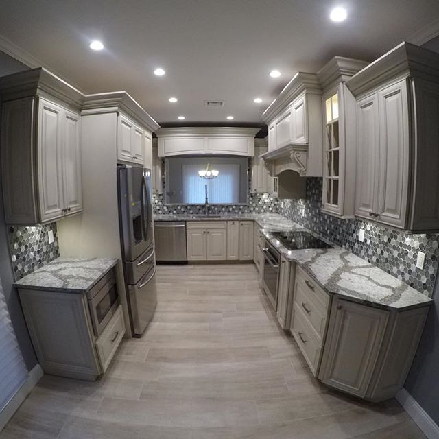 The process of designing and renovating a kitchen can be somewhat overwhelming. It helps to hire a contractor that is well versed in the latest industry trends and provides unique ideas that work for both the design and functionality of the new kitchen space. We will help you select your: Appliances, Cabinetry, Cabinetry Hardware, Countertops, Backsplash Tile, Under Cabinet Lighting, LED Task & Recessed Lighting, Island Pendant Lighting, Flooring, Sinks, Faucets, & Pot Fillers. We are highly experienced kitchen contractors, priding ourselves on quality workmanship, reliability, and dedication to the total customer experience/satisfaction. Make one phone call to Cascella & Sons @ 631-582-0100 and leave the rest to us!! . . . #smithtown #kitchendesignideas #smithtownkitchen #customhood #kitchen #interior #modern #luxury #decor #design #cabinet #residential #interiordesign #glasstile #kitchenremodel #kitchensofinstagram #glasstilebacksplash #potfiller #luxurykitchen #stainlesssteel  #kitchendesign