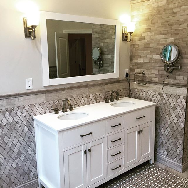 Cascella & Sons installed this elegant marble master bathroom. Custom marble mosaic tile inlay, luxurious  shower area, recessed soap & shampoo dish, body sprays, euro roller glass doors, concealed tiled linear drain, double sink white marble top vanity & free-standing soaking tub. Clean lines and great material selections make for a tranquil and relaxing getaway in this newly renovated master bathroom. . . . #bathroomdesign #remodel #remodeling #luxurybathroom #renovation #homereno #homerenovation #bathroomrenovation #tiledesign #tile #showerdesign #lineardrain #bathtime #bathtubs #soakingtub #bathroomsofinstagram